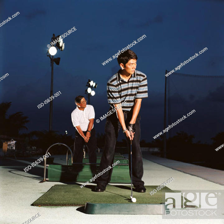 Stock Photo: Men practising on driving range.