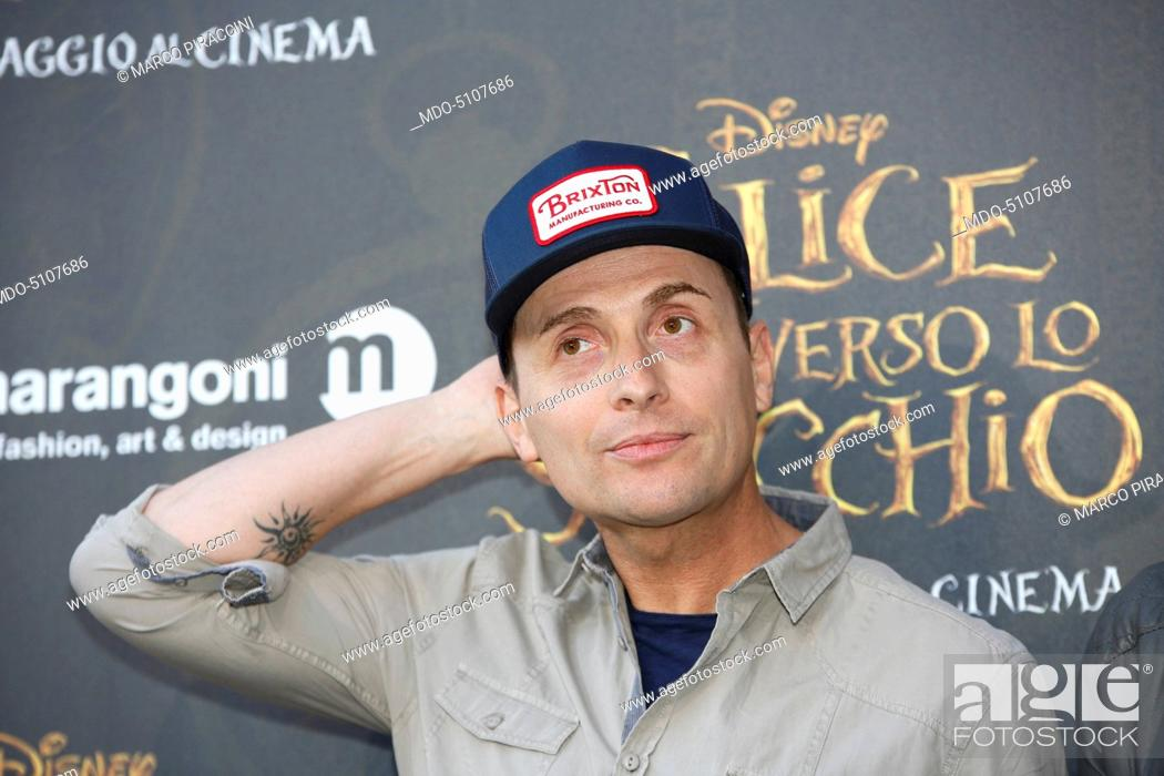 Stock Photo: Italian TV celebrity, actor and mimic Angelo Pintus posing on the red carpet at the national premiere of the film Alice Through the Looking Glass staged at.