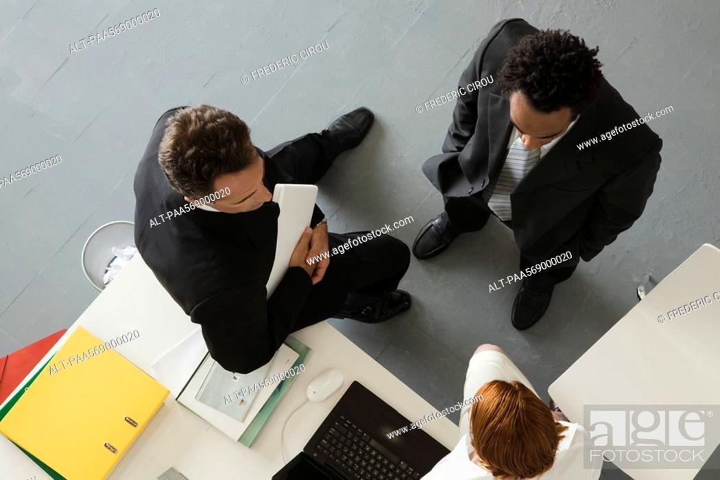 Stock Photo: Business people in office having informal meeting.