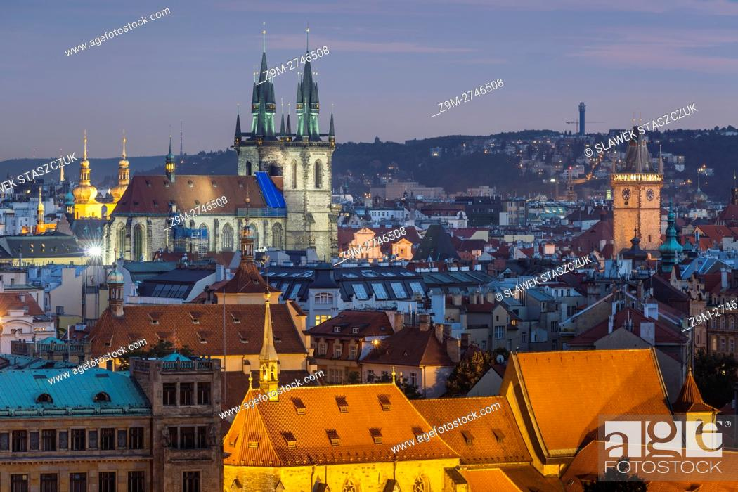 Stock Photo: Night falls over Prague old town, Czech Republic. Our lady before Tyn church dominates the skyline.