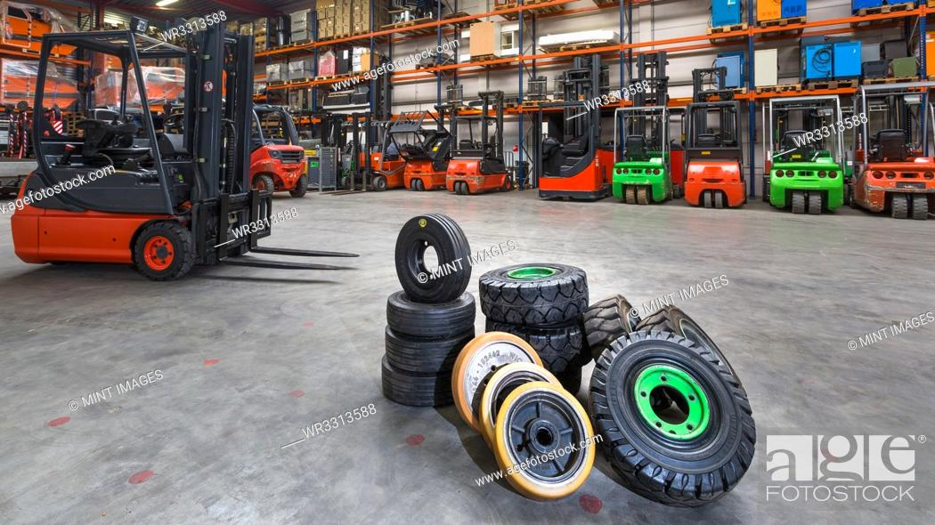 Stock Photo: Forklift tires in warehouse.