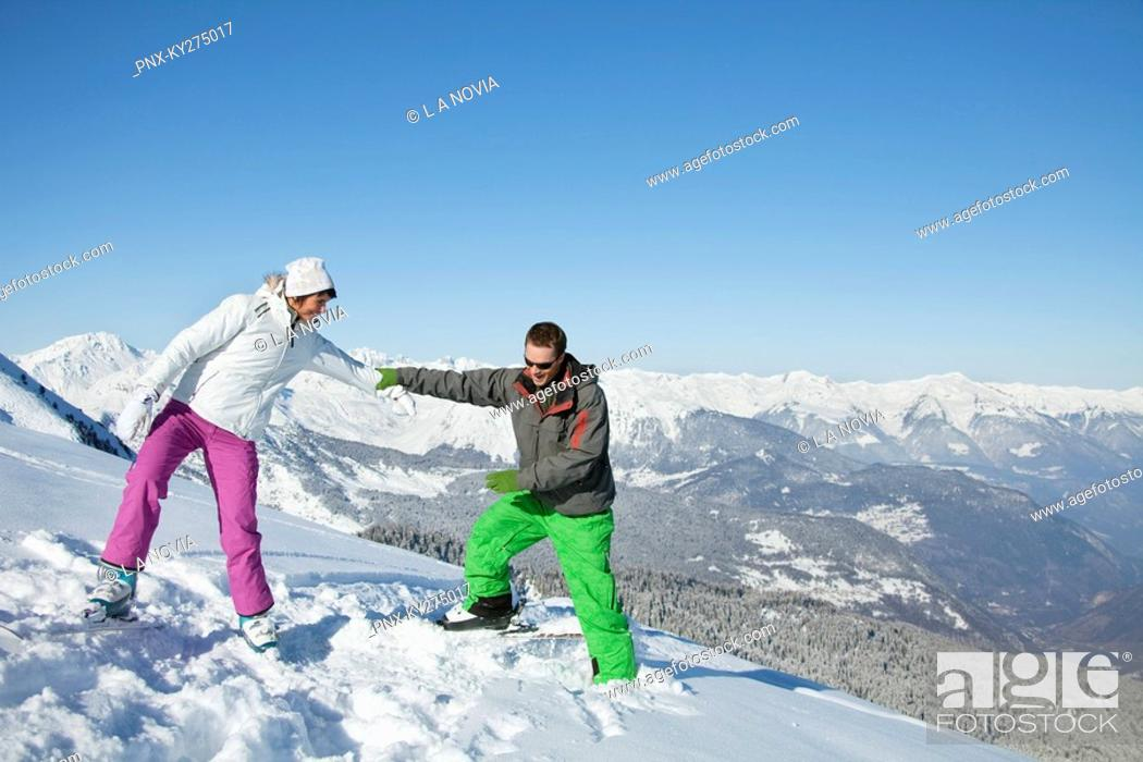 Stock Photo: Young couple of skiers on slope.