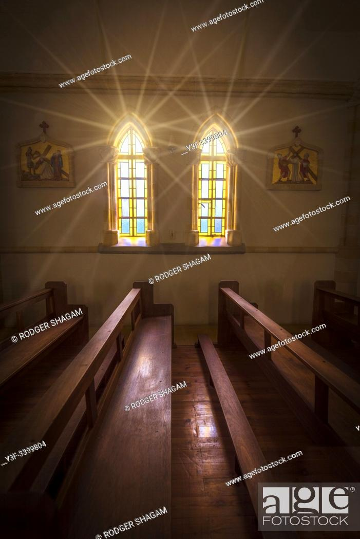 Stock Photo: Sunbursts throufh the church window. Vanrhynsdorp is a town within the diocese of Keimoes-Upington in the West Coast district of the Western Cape, South Africa.