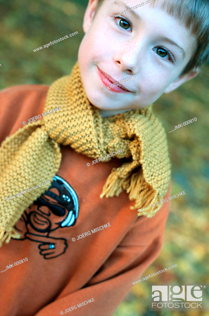 Stock Photo: Little boy in the autumnal wood, forest, smiling.