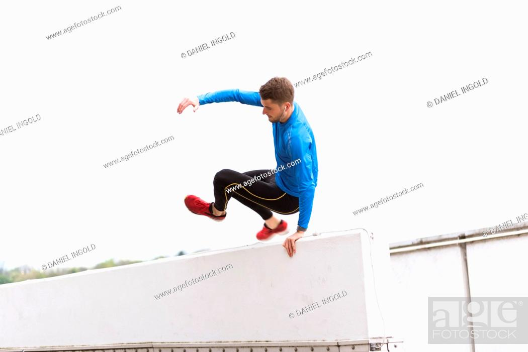 Stock Photo: Young athlete crossing a wall.