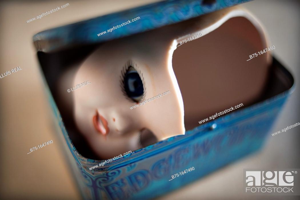 Stock Photo: Broken dollÂ's head in a box.
