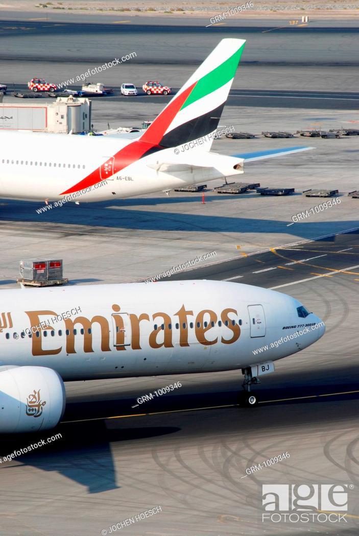 Stock Photo: Aircrafts of Emirates Airline Fleet at Dubai International Airport, Dubai, UAE.