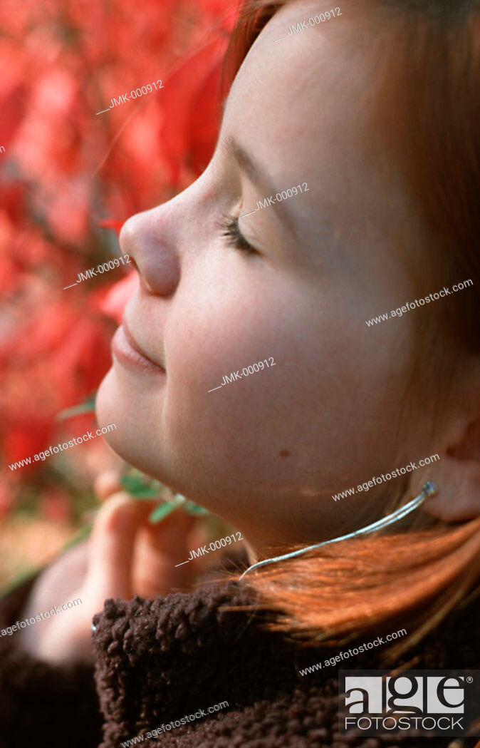 Stock Photo: Portrait of a little girl in the garden with closed eyes, dreaming.