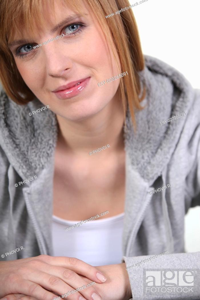 Stock Photo: Woman in a grey hooded sweatshirt.