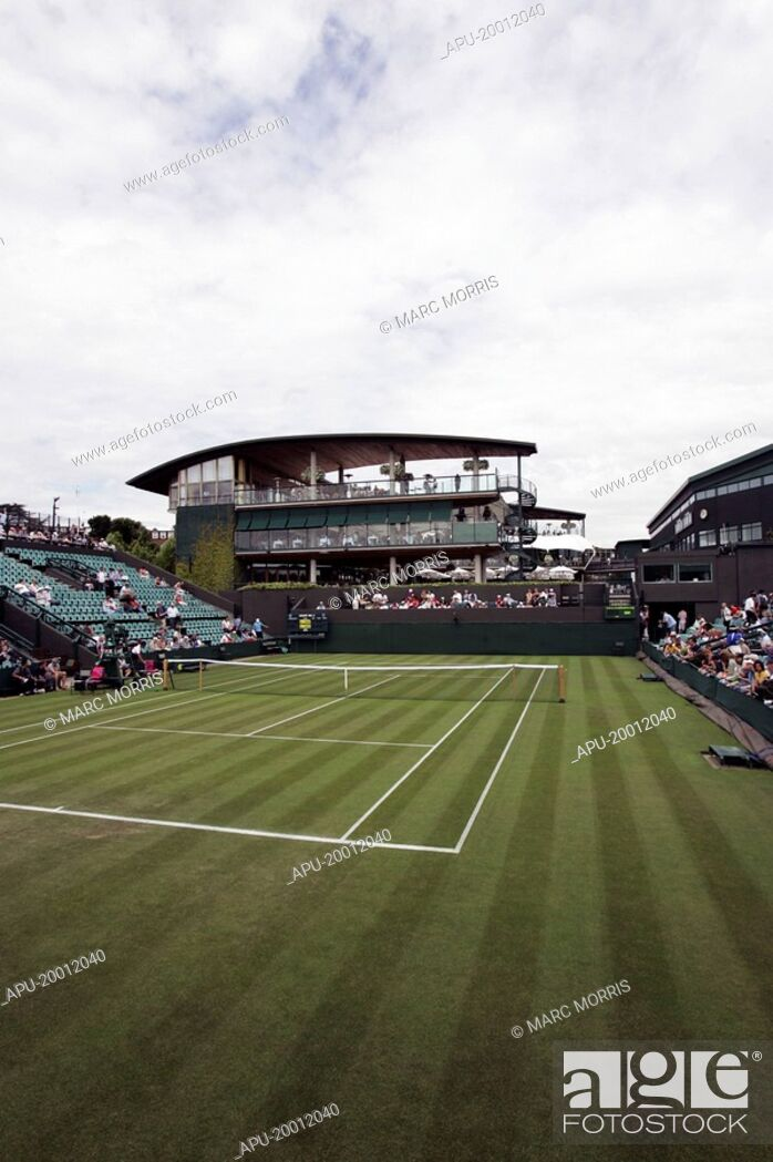 Stock Photo: Grass tennis court with a stadia.