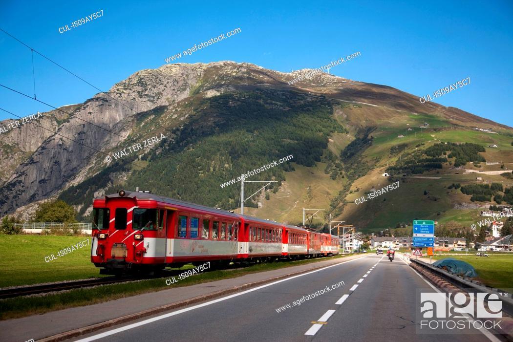 Stock Photo: Train running parallel to road, Gotthard Pass, Ticino, Switzerland.