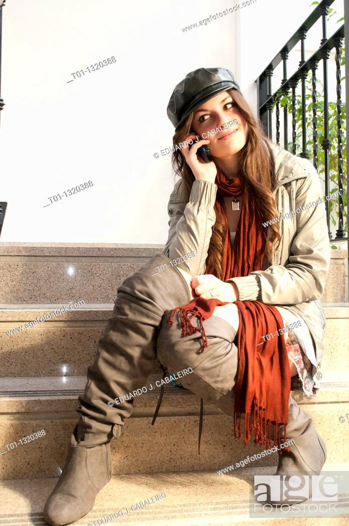 Stock Photo: fashion girl talking on mobile phone.