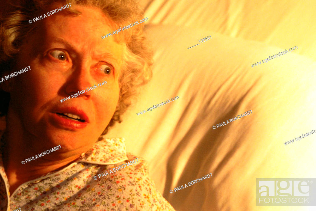 Stock Photo: Senior woman afraid in bed.