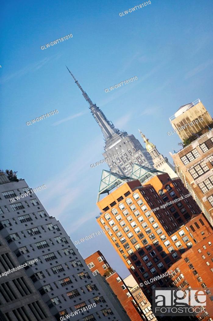 Stock Photo: Low angle view of buildings, Empire State Building, Manhattan, New York City, New York State, USA.