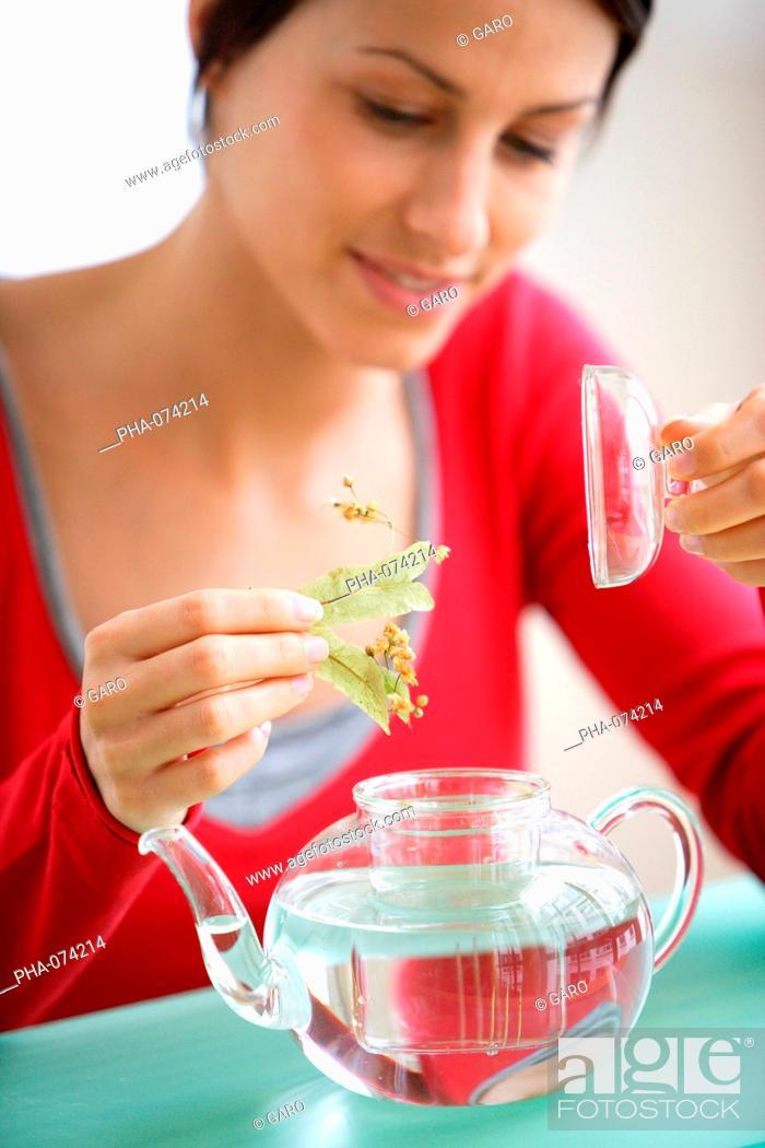 Stock Photo: Woman preparing herbal tea.