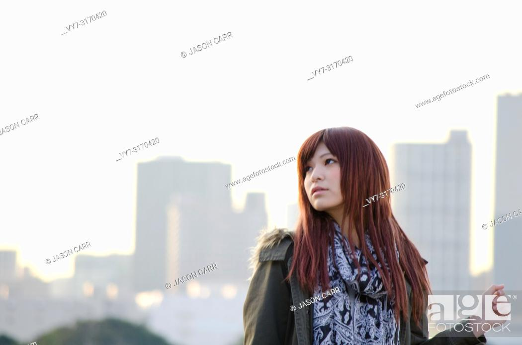 Stock Photo: Japanese Girl poses on the street in Odaiba, Japan. Odaiba is a area by the sea in Tokyo.
