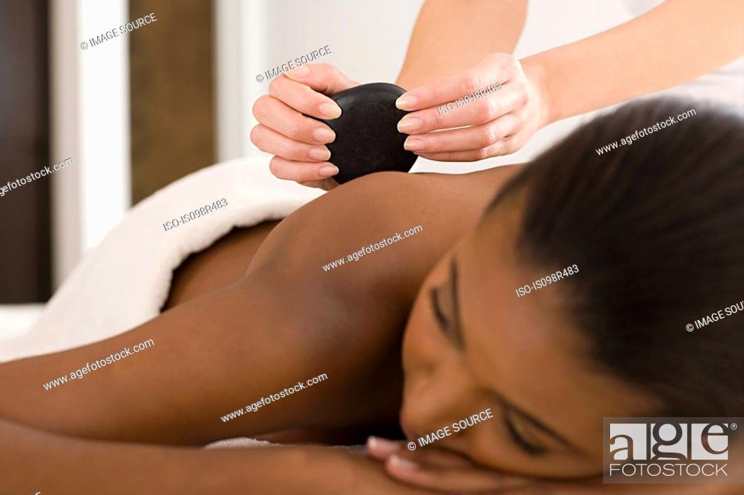 Stock Photo: Woman having stone massage.