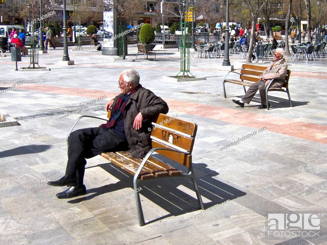 Stock Photo: Elderly men sitting in plaza Granada spain.