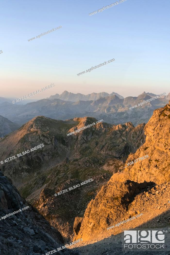 Stock Photo: Warm sunrise at Pyrenees mountain range, border between France and Spain. Orange and teal colors are the main on this picture.