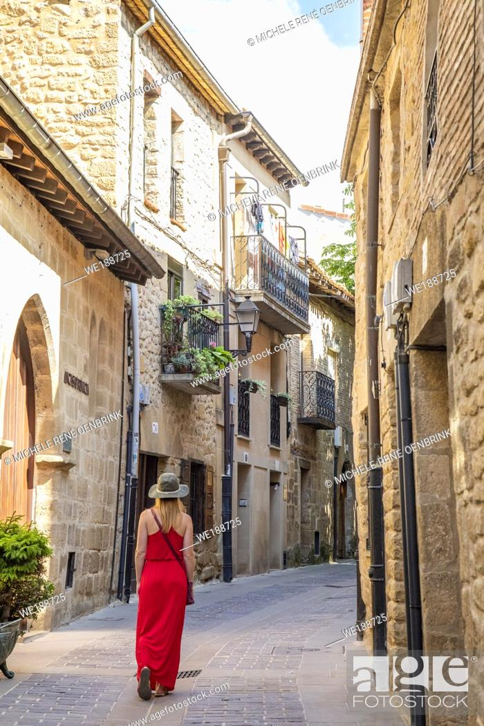 Stock Photo: Tourist woman walking down street in Laguardia Rioja alavesa wine route. Alava. Basque country. Spain.