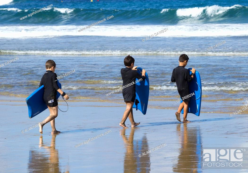 Stock Photo: Bodyboarding lesson for Spanish schoolchildren at La Cicer, Playa de Las Canteras, Las Palmas, Gran Canaria, Canary Islands, Spain.