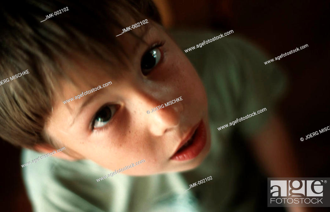 Stock Photo: A little boy, 5-10 years old, looking up.