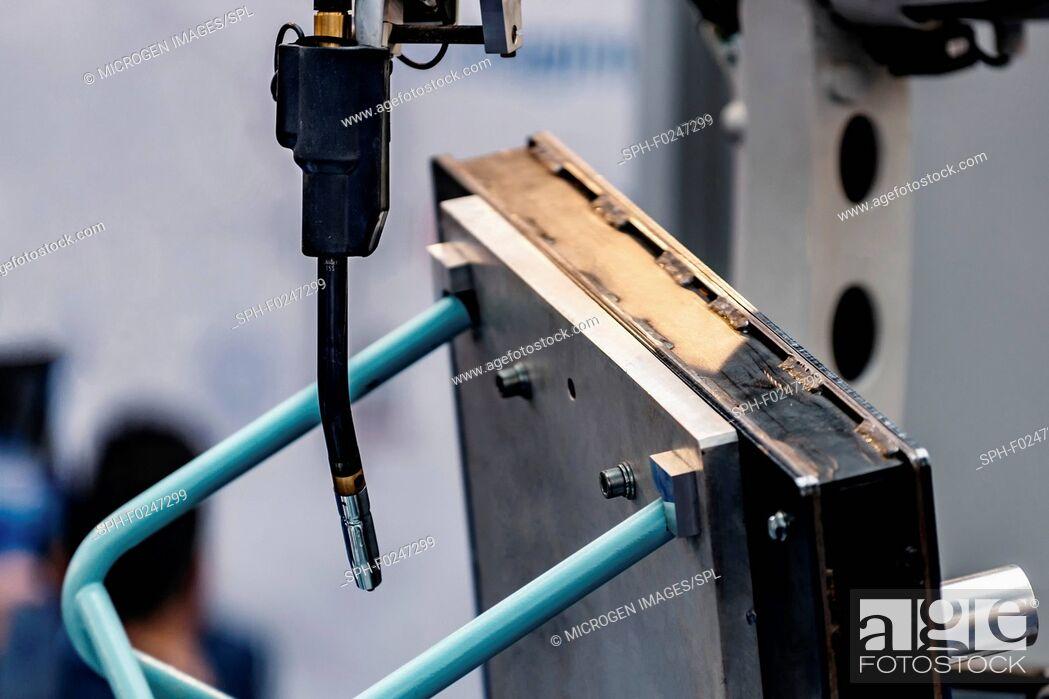 Stock Photo: Arc welding robot, close-up.