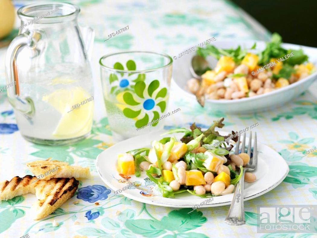 Stock Photo: Vegetarian Bean and Squash Salad on a Plate on Table.
