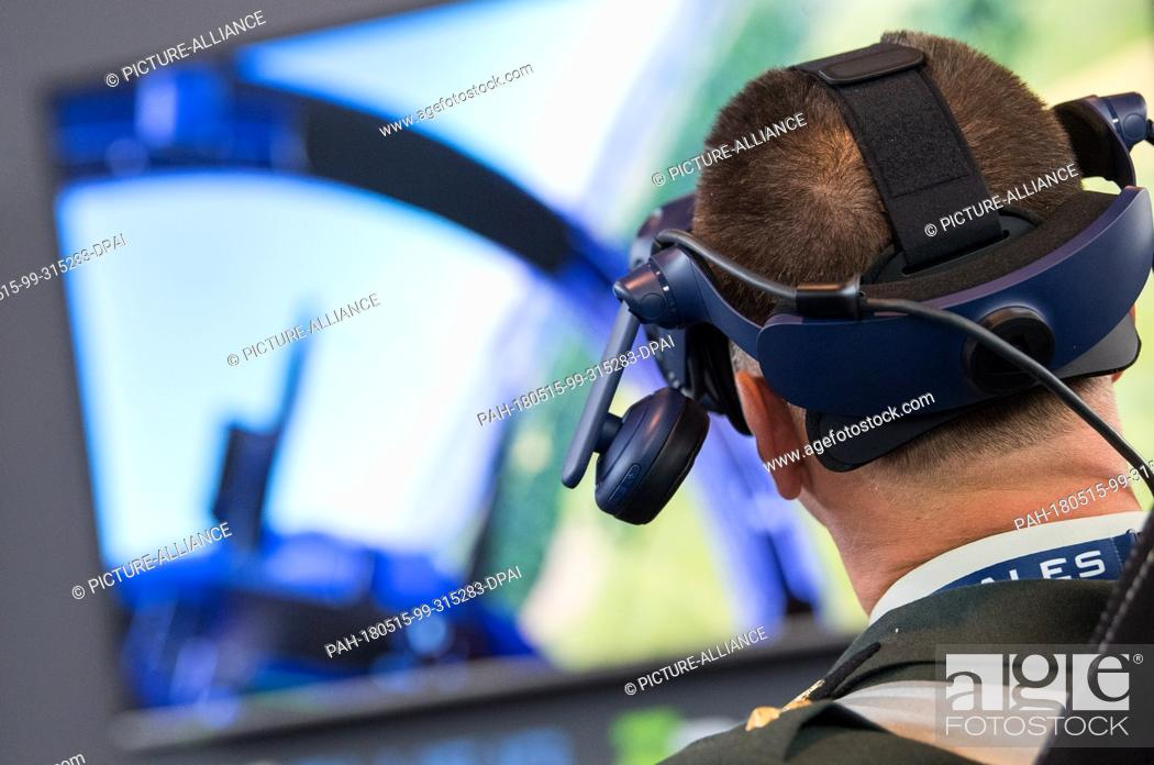 15 May 2018, Germany, Stuttgart: A visitor uses the flight simulator