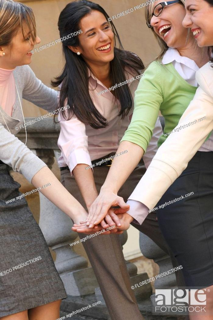Stock Photo: Businesswomen in a huddle.