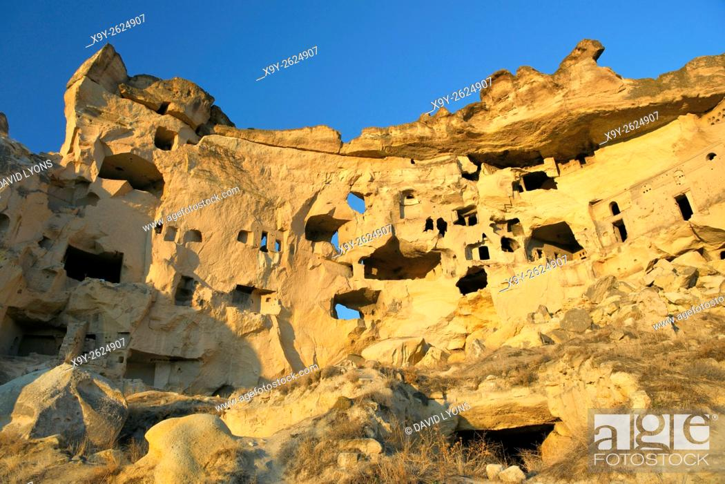 Stock Photo: Part of cliff dwelling complex of ancient Christian churches and houses in village of Cavusin near Goreme, Cappadocia, Turkey.