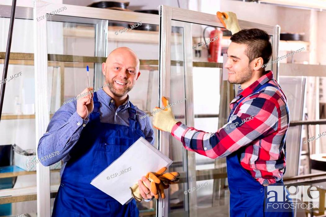 Stock Photo: Two workers inspecting windows.