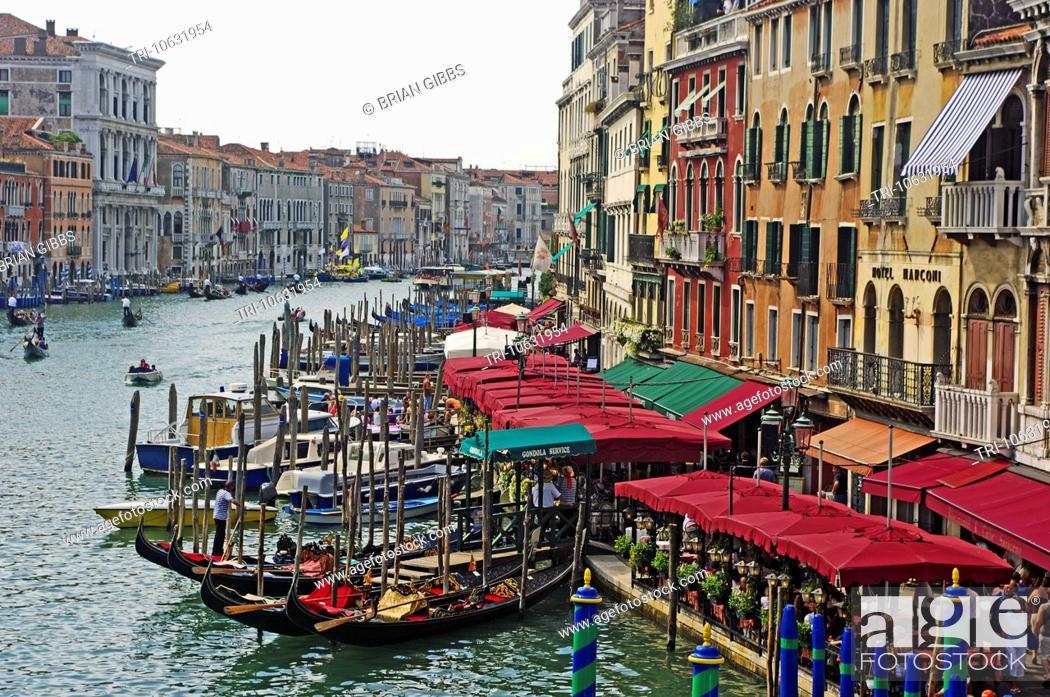 Stock Photo: Gondolas Cafe and Buildings by Rialto Bridge Grand Canal Venice Veneto Region Italy.