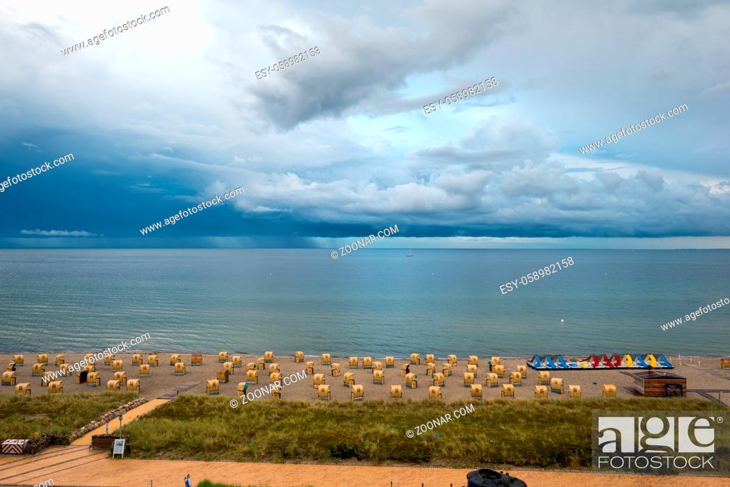 Stock Photo: Clouds and rain above Baltic Sea, seen from the south beach in the village Burgrtief in the south of the island Fehmarn. The island is situated in the north of.