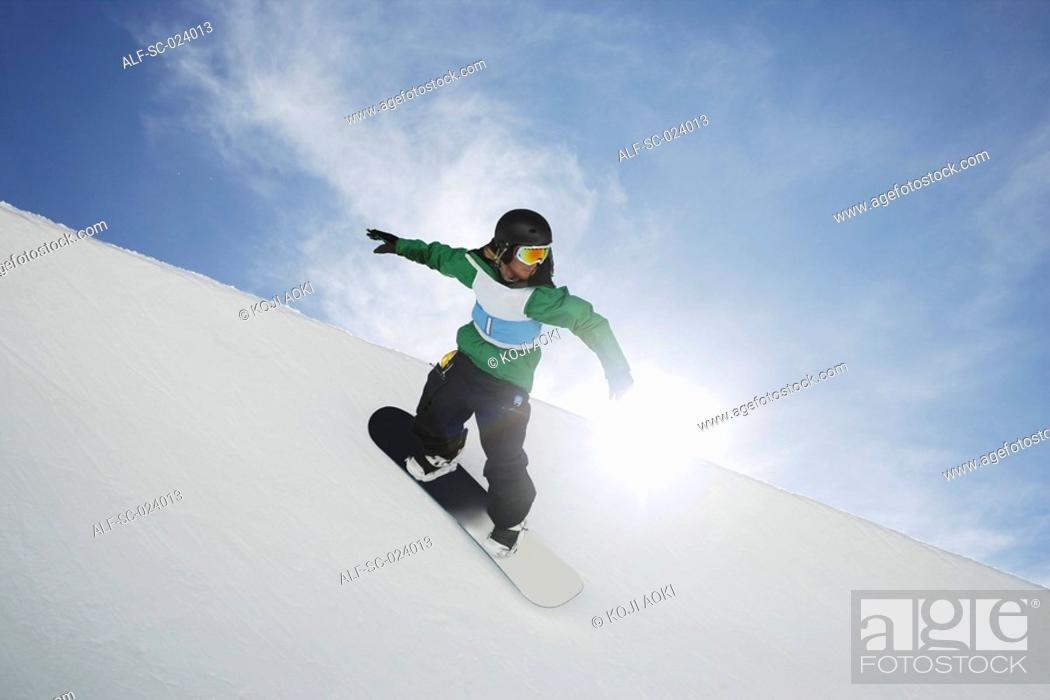 Stock Photo: Snowboarder Riding a Half Pipe.