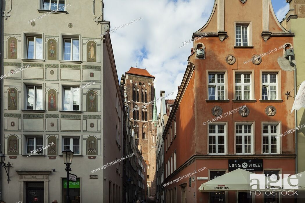 Stock Photo: Narrow street in Gdansk old town, Poland. St Mary's basilica tower in the distance.