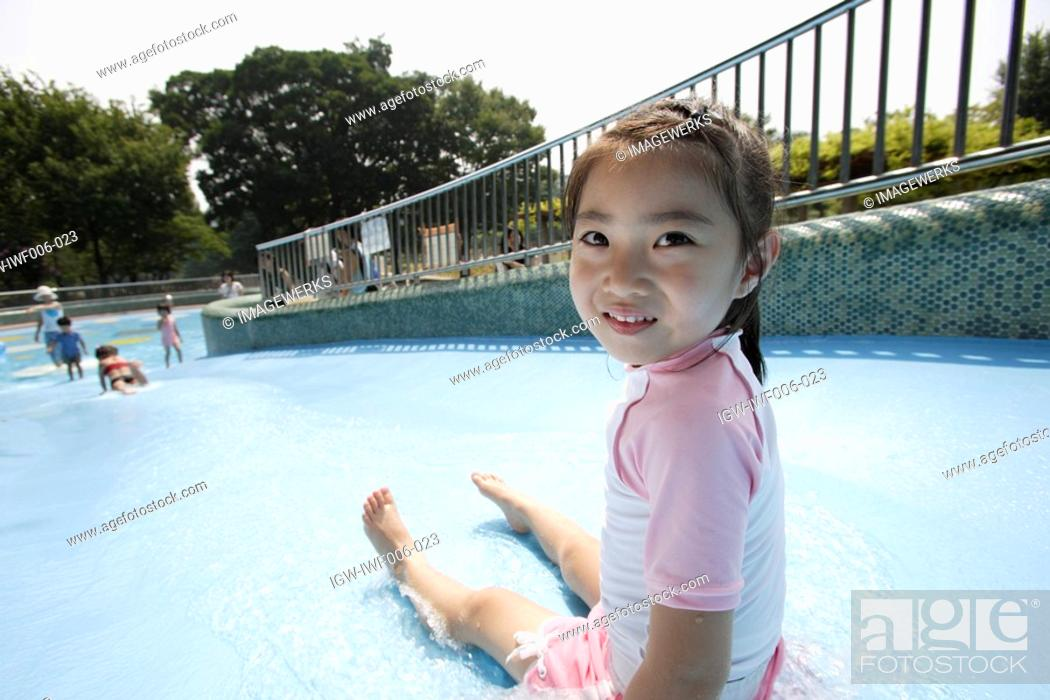 Stock Photo: A girl at water slide.