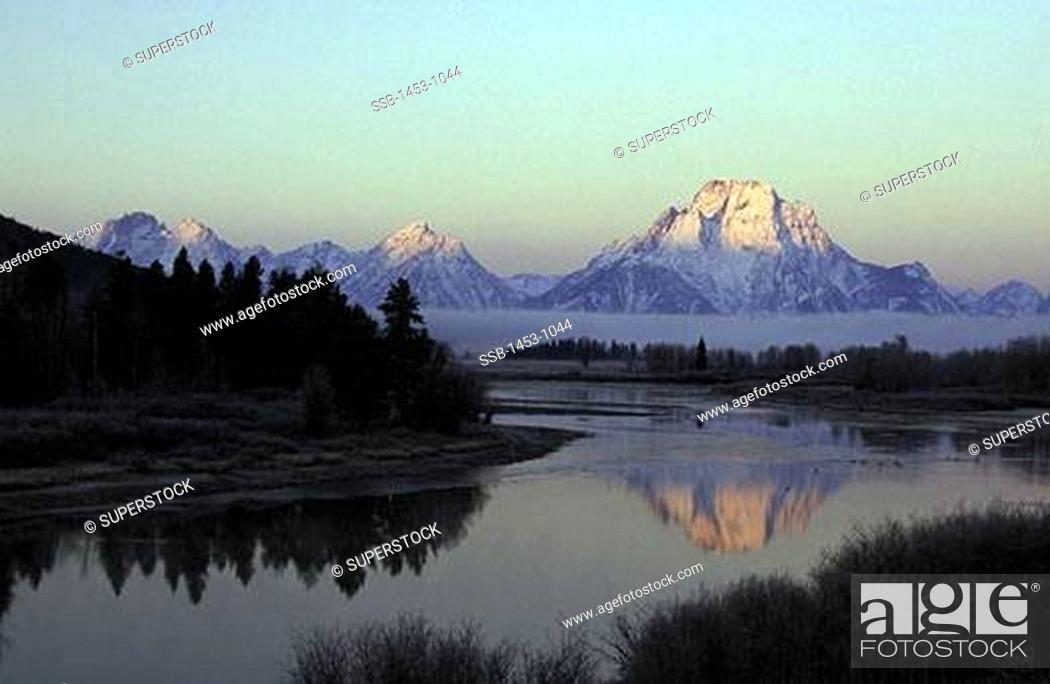 Stock Photo: Reflection of a mountain in a river, Teton Range, Grand Teton National Park, Wyoming, USA.