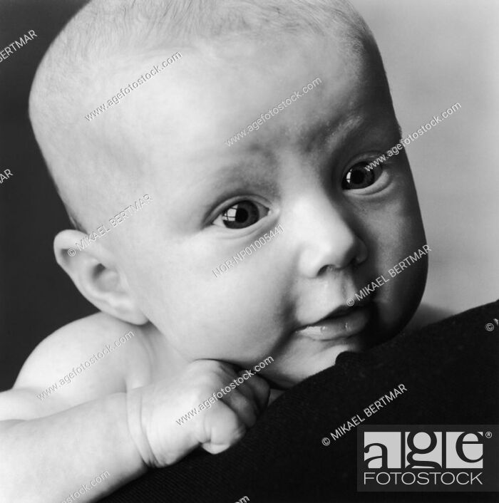 Stock Photo: Close-up of a baby girl looking away.