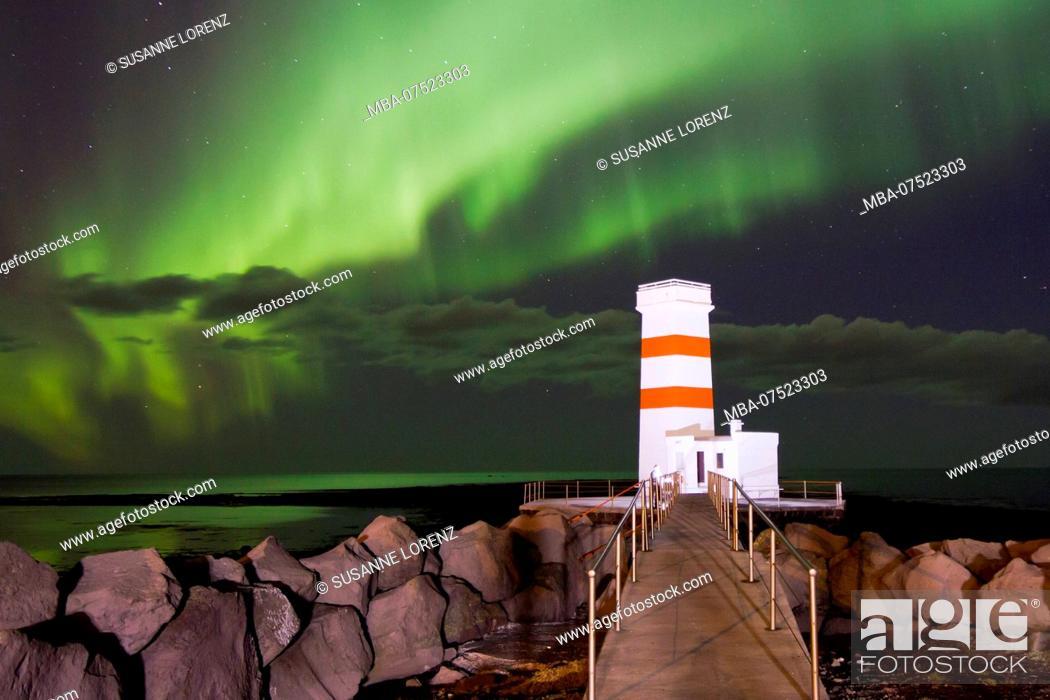 Stock Photo: Spectacular aurora borealis above the lighthouse of Gardur, Iceland.