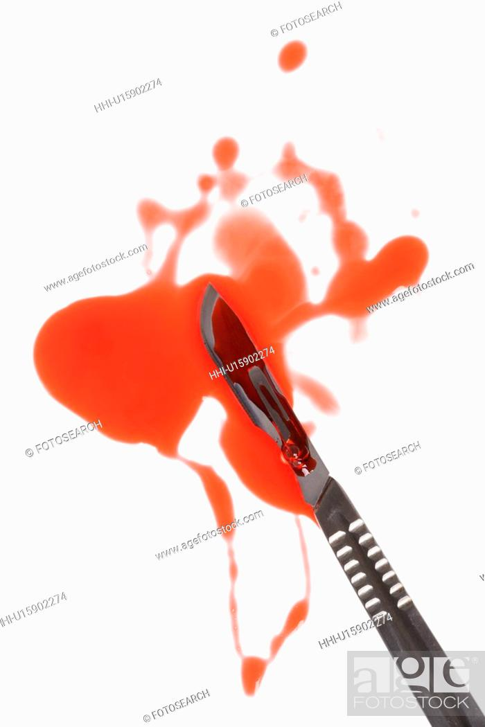 Stock Photo: Medical scapel with fake blood around it.