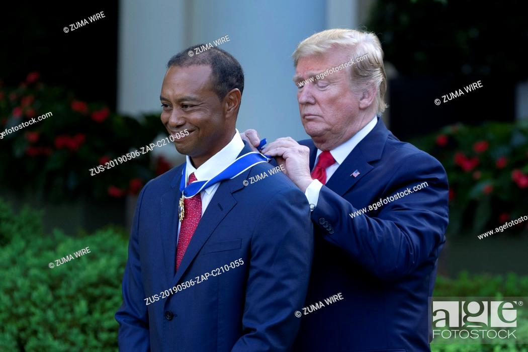 Stock Photo: May 6, 2019 - Washington, District of Columbia, United States - TIGER WOODS receives the Presidential Medal of Freedom from President DONALD TRUMP in the Rose.