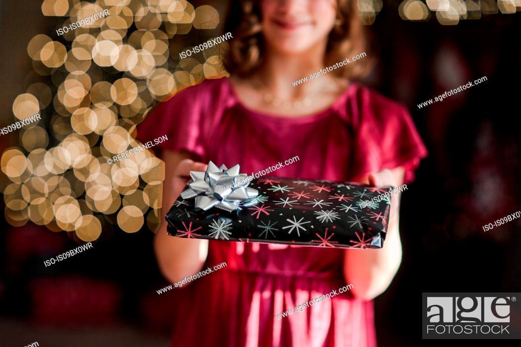 Stock Photo: Girl holding Christmas gift.