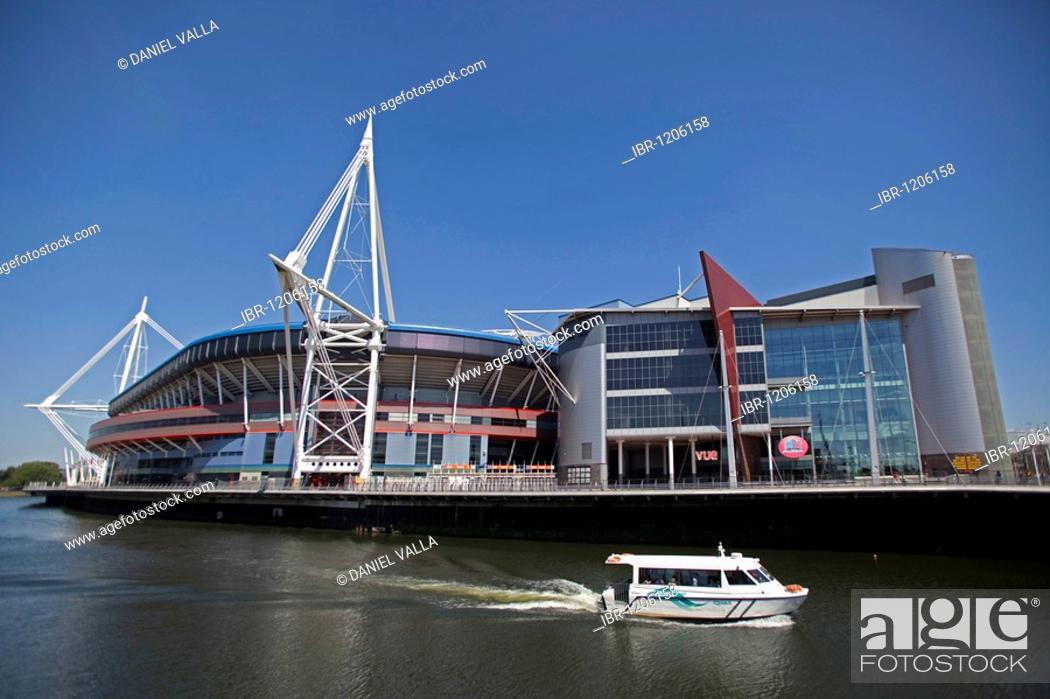 Stock Photo: Millennium Stadium sports centre with boat on river, Cardiff, Wales, United Kingdom, Europe.