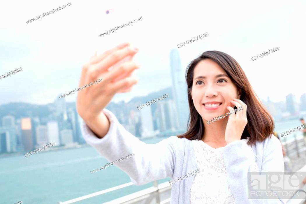 Stock Photo: Woman taking selfie image by mobile phone.