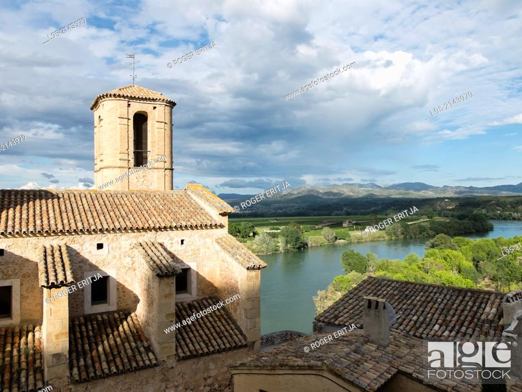 Stock Photo: Church of Miravet perched over the Ebro river, Spain.