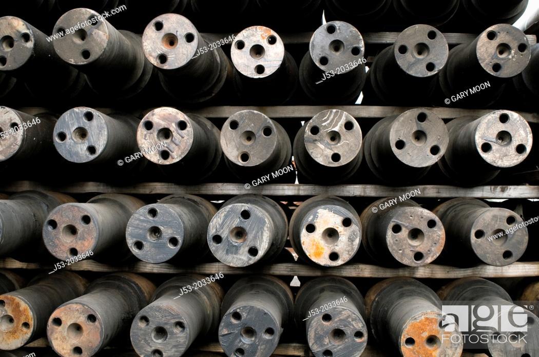 Stock Photo: Axles for railroad train wheels stored at machine shop awaiting assembly, Tacoma, Washington USA.