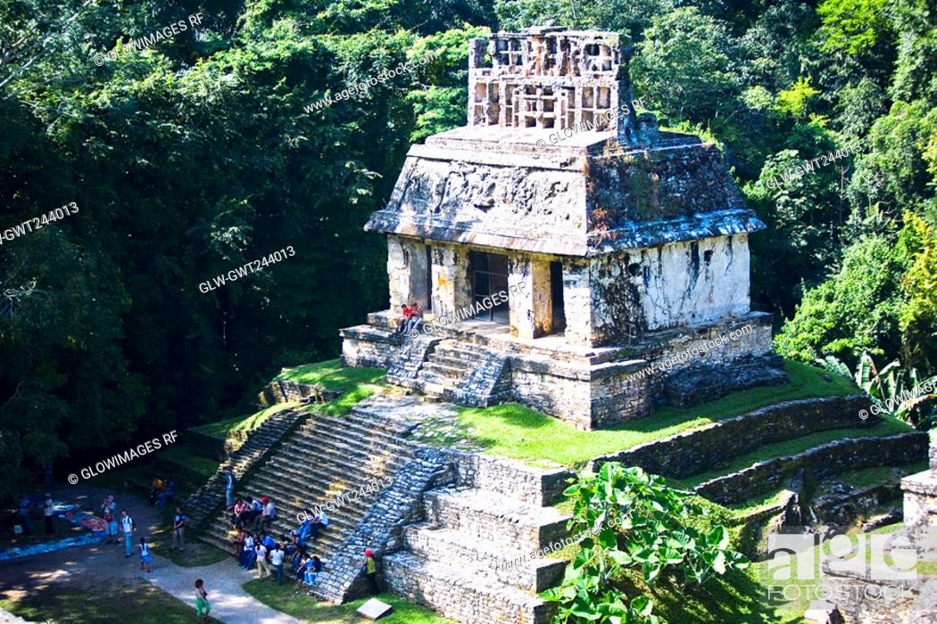 Stock Photo: High angle view of tourists at old ruins of a temple, Templo Del Sol, Palenque, Chiapas, Mexico.