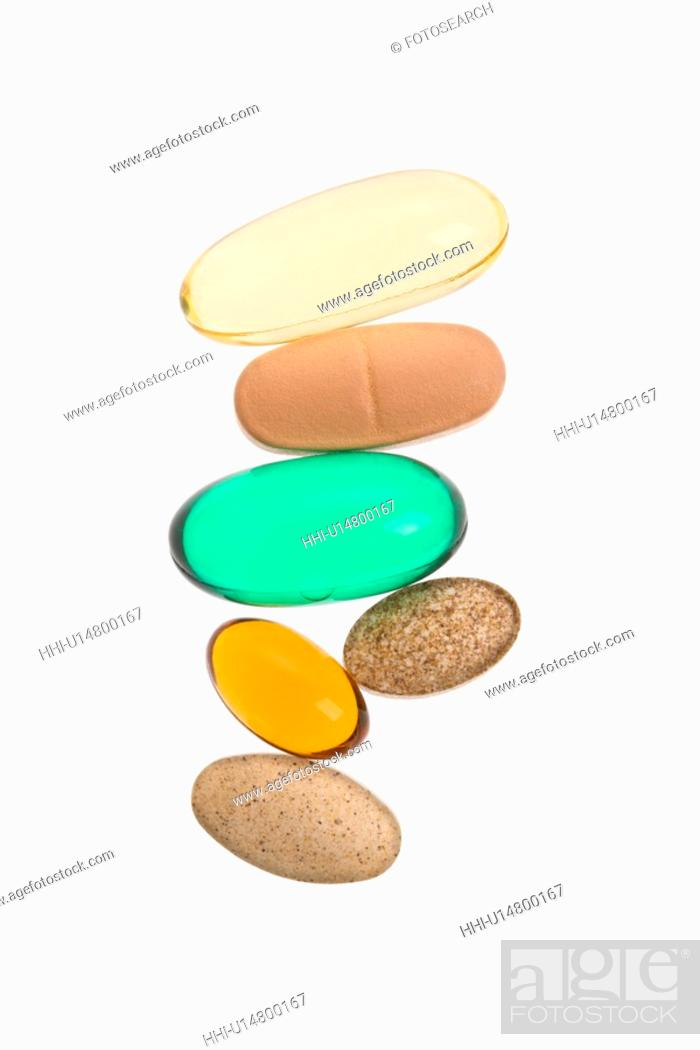 Stock Photo: Close up of supplement vitamin pills against white background.