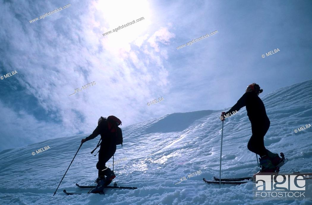 Stock Photo: Couple cross country skiing, rear view  Pyrenees Lles  Catalonia  Spain.